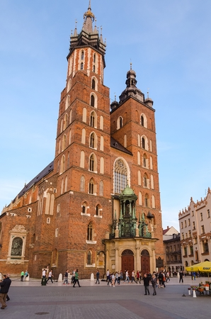 tenement buildings: KRAKOW POLAND MAY 29 2015: St. Mary39s Church in Krakow. Main market square in Krakow Poland listed by the UNESCO organization. Editorial