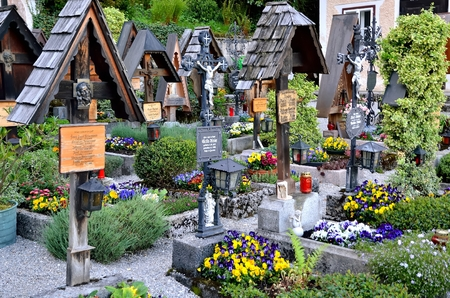 promoted: Hallstatt AUSTRIA MAY 3 2013: Cemetery in Hallstatt village in Austria Alps. Hallstatt is historical village nestled in the Austrian Alps at the Hallstatter lake and promoted by UNESCO39s World Heritage region.