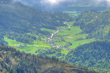 loser: Village in the Austrian mountains. Road winding through the village view from the Loser peak in the Dead Mountains Totes Gebirge in Austria.