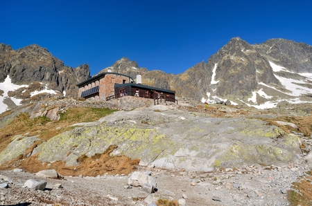 mountainscape: Mountain Chalet. Highmountain hostel called Teryho cottage in the Valley of the Five Lakes Table of Tatra mountains in Slovakia. Stock Photo