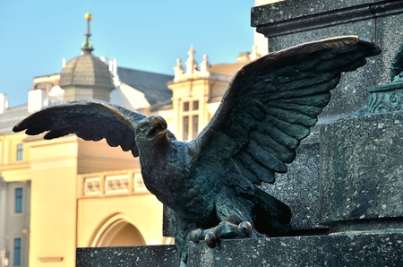 mickiewicz: KRAKOW POLAND OCTOBER 21 2012: Bronze eagle. Closeup of a statue of Adam Mickiewicz on the main square in Krakow Old Town in Krakow is listed by the UNESCO organization. Editorial
