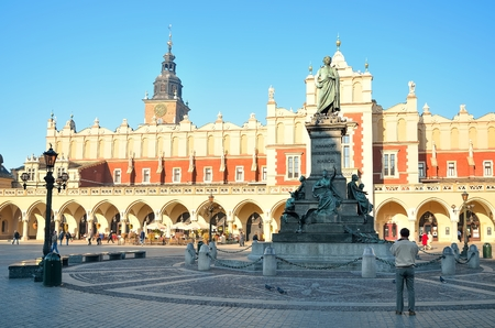 mickiewicz: KRAKOW POLAND OCTOBER 21 2012: The statue of Adam Mickiewicz and Cloth Hall Cloth Hall on the main square in Krakow. Old Town in Krakow Poland is listed by the UNESCO organization. Editorial