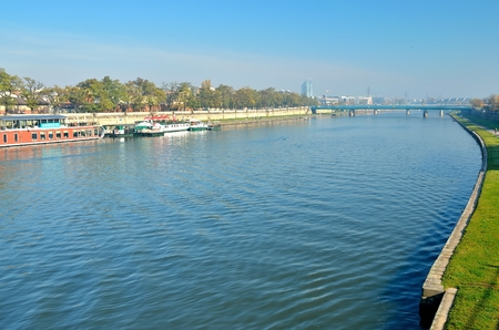 malone: KRAKOW POLAND OCTOBER 21 2012: Vistula river in Krakow. Aerial view of the Vistula river Wisla in the historic city center of Vistula is the longest river in Poland. Editorial