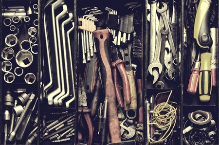toolset: Tool box. Toolset with interior compartments to keep wrenches, ring spanners, hammer, pliers, screwdrivers, monkey wrenches, screws, bolts, wire and other do-it-yourself (DIY) tools.