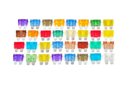 car fuse: Car fuse. Top view of colorful electrical automotive fuses or circuit breakers isolated on white background. Stock Photo