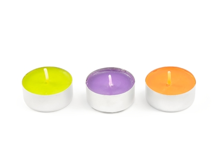 tea light: Three tea lights. Colorful tea light candles isolated on white background. Stock Photo