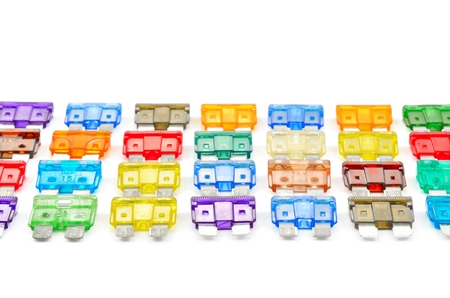 Car fuse. Close-up of colorful electrical automotive fuses or circuit breakers isolated on white background. Stock Photo