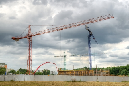 residential construction: Construction site with cranes. Construction of residential buildings.