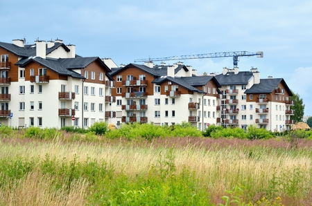 town houses: New housing estates. Public view of newly built block of flats in the green area. Stock Photo