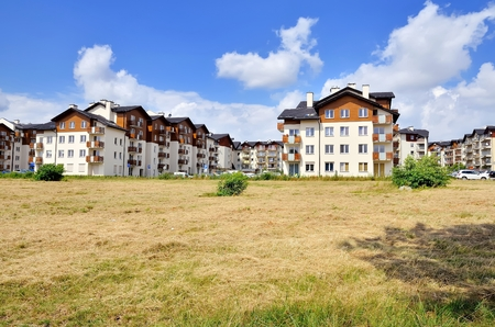 annuities: New housing estates. Public view of newly built block of flats in green area.