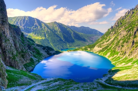 Summer mountain landscape. Beautiful lake in mountains. Black Pond Black Pond under Features, lake is the most popular place in the High Tatra Mountains, Poland. 스톡 콘텐츠
