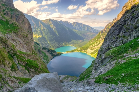 Two lakes in mountains. Two blue mountain lakes surrounded by high summits. Sea Eye Eye of the Sea and Black Pond Black Pond are the most popular place in the High Tatra Mountains, Poland.