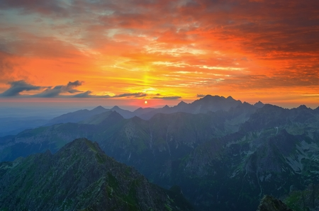 Mountain landscape. Polish and Slovak Tatra Mountains at sunrise.