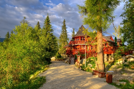 hut: Wooden hut. Hut is situated on the Strbske Pleso Lake in High Tatra Mountains, Slovakia. Stock Photo