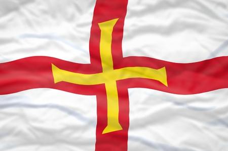 guernsey: Guernsey flag. Wavy flag of Guernsey fills the frame.