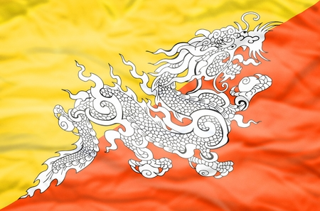 bhutan: Bhutan flag. Wavy flag of Bhutan fills the frame. Stock Photo