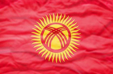 kyrgyzstan: Kyrgyzstan flag. Wavy flag of Kyrgyzstan fills the frame.