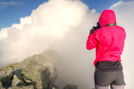 spectre: Mountain sunrise landscape. A brocken spectre and tourist in High Tatra Mountains, Slovakia.