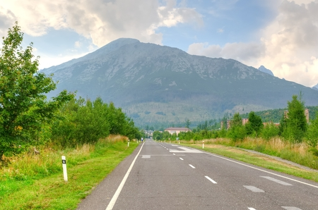 stary: Road and mountains. Road to Stary Smokovec village in High Tatra, Slovakia.