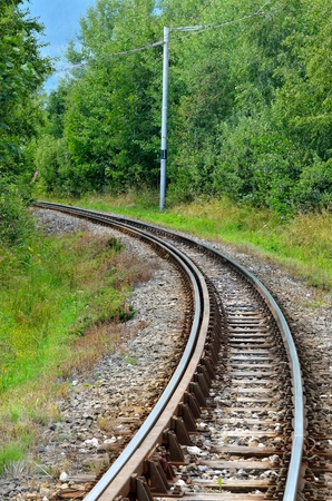 forest railroad: Railroad tracks. Railroad tracks and forest in Nova Lesna village in Slovakia. Stock Photo