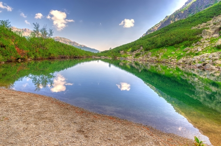 friction: Summer landscape. Lake in mountains. Friction Kemarsk Pleso in the High Tatra Mountain, Slovakia.