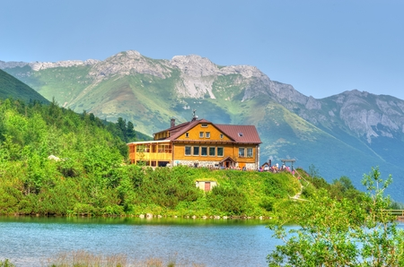 chalet: Summer landscape. Lake and mountain chalet. Zelene Pleso lake and a chalet in the High Tatra Mountains, Slovakia. Editorial