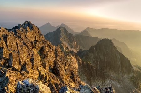 scenic landscapes: Summer landscape. Sunrise in mountains. View from Aries Rohy peak in the High Tatra Mountains, Slovakia. Stock Photo