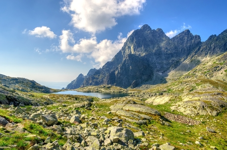 plies: Summer mountain landscape. View on the Five Lakes Valley basin Spiskie Piatich Spisskych plies in High Tatra Mountains, Slovakia. Stock Photo