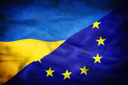 emblem of ukraine: Ukraine and European Union mixed flag. Wavy flag of Ukraine and European Union fills the frame.
