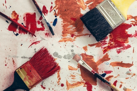 spilled paint: Brushes and spilled paint on the floor. Stock Photo