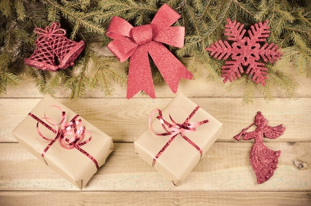 christmas ornamentation: Christmas decor. Gifts, branches of christmas trees and christmas decorations on wooden boards. Stock Photo