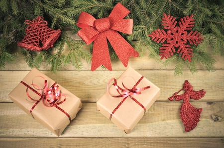 christmas decor: Christmas decor. Gifts, branches of christmas trees and christmas decorations on wooden boards. Stock Photo