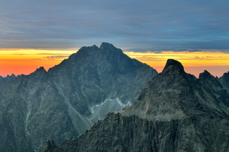 travel features: Mountain landscape at sunset. View of the cracks on Gerlach Peak Gerlachovsk and porch Stit Peak in the High Tatra Mountains, Slovakia.