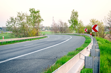 sharp curve: Curvy asphalt road. A sharp bend on the highway. Stock Photo