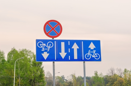 stopping: Traffic signs on the street. Road signs for bicycles and no stopping.