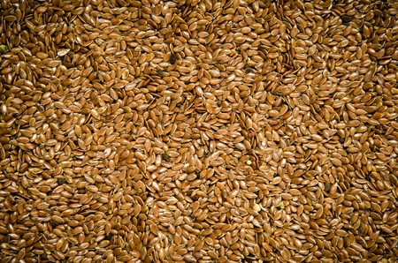 brown flax: Brown flax seeds. Healthy food on the pile, may be used as background. Stock Photo