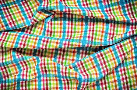 grille: Wrinkled texture material rag. Colorful fabric background checkered.
