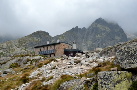 HIGH TATRA, SLOVAKIA - AUGUST 19, 2015: Mountain chalet. High-mountain hostel called Teryho Chata in the valley of the Five Spis Lakes in Tatra mountains, Slovakia. Stock Photo