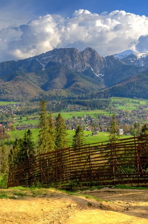 giewont: Beautiful spring mountain and rural landscape. View on the Tatra Mountains and Koscielisko Village in Poland.