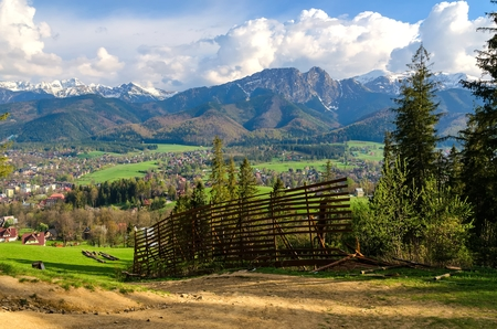 giewont: Beautiful spring mountain and rural landscape. View on the Tatra Mountains and Zakopane Town and Koscielisko Village in Poland.