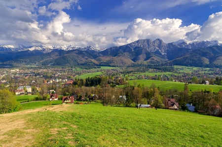 giewont: Beautiful country view with mountains in the background. View of the Tatra Mountains, Zakopane Town and Koscielisko Village in Poland. Stock Photo