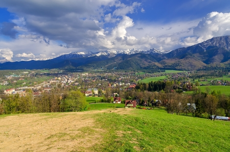 Beautiful country view with mountains in the background. View of the Tatra Mountains, Zakopane Town and Koscielisko Village in Poland.