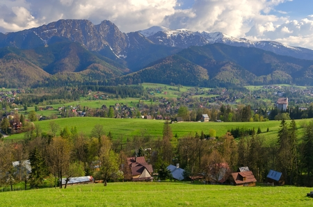 giewont: Beautiful country view with mountains in the background. View of the Tatra Mountains and Koscielisko Village in Poland.