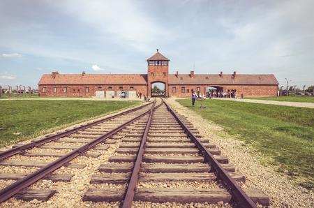 auschwitz memorial: OSWIECIM, POLAND - MAY 12, 2016: Main gate in Auschwitz Birkenau in Brzezinka, Poland.