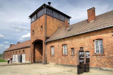 concentration camp: OSWIECIM, POLAND - MAY 12, 2016: Main gate in concentration camp Auschwitz Birkenau II in Brzezinka, Poland. Editorial