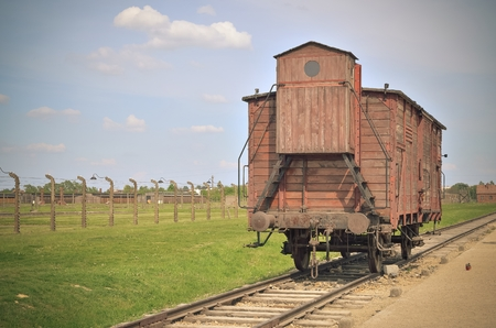 concentration camp: OSWIECIM, POLAND - MAY 12, 2016: Car train in concentration camp Auschwitz-Birkenau II in Brzezinka, Poland. Transport wagon used for deportation to concentration camp. Editorial