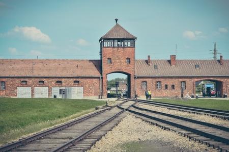 auschwitz memorial: OSWIECIM, POLAND - MAY 12, 2016: Main gate in concentration camp Auschwitz Birkenau II in Brzezinka, Poland. Editorial