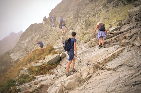 HIGH TATRA MOUNTAINS, SLOVAKIA - SEPTEMBER 15, 2016: Tourists on a mountain trail in the High Tatra, Slovakia. Redakční