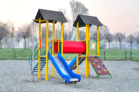 Childrens playground. Colorful slide on the playground in the city park. Stock Photo
