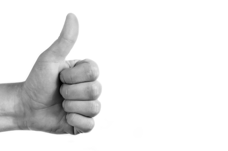 super man: Positive symbol on white isolated background. Hand showing the thumb that is ok. Stock Photo